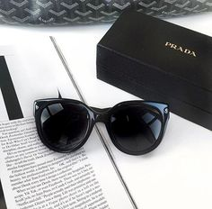 While trying to organize my mess @my storage rental I found a pair of Prada Sunglasses that I didn't  know I had. They don't look like these in the photo but are black shield style type but this is the thing about them, the lenses both inside & out are what looks like crackled irridescent lenses. At first I though they were ruined that I somehow must have melted them when cleaning them off-I discover it doesn't come off. WTF? Can anyone tell me about these lenses? I googled sku# & find…