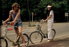 .john & yoko biking in Central Park (right across the street from where they lived in the DAKOTA's --- Gorgeous top floor of very old architecture.