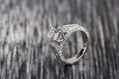 Pre-owned ladies 14k white gold and diamond engagement ring featuring a .71 carat emerald cut center stone of SI-2 clarity and E/F color. This stone is accented by 16 channel set, straight baguettes of VS-1/VS-2 clarity and F/G color, weighing a total of .36 carats. As well as, 44 round full cut diamonds of VS-2/SI-1 clarity and G-H color, weighing a total of .44 carats. This piece is a size 4.5 and is in very good condition.