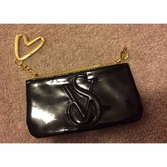 Mini Victorias Secret black coin bag/cosmetic bag Black mini Victoria's Secret bag. Can be used as a coin bag, cosmetic bag, whatever you want! Never used. Victoria's Secret Bags Clutches & Wristlets