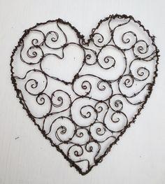 Burly Spirillian Barbed Wire Heart of Spirals For Your Valentine Garden Trellis. $ 75.00, via Etsy. by darstar