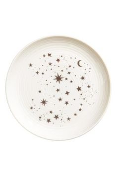 Printed porcelain plate: Porcelain plate with a star print. Diameter 15.5 cm.