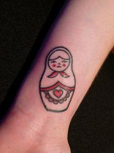 Small Matryoshka Tattoo On Arm photo - 1