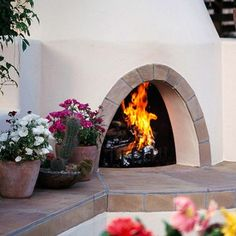 An enclosed Southwest design style patio with outdoor fireplace and shelf seating attached to Southwest color stucco walls. Description from pinterest.com. I searched for this on bing.com/images