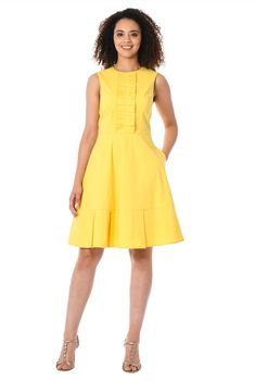 Ruffle pleats front our cotton poplin dress designed to flatter your figure with a princess seamed bodice and a pleated flounce at the flared skirt.