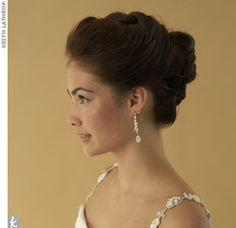 the braided bun  Sweet and sophisticated rolled into one. This tucked and twisted up do is fit for a seaside celebration or a more glamorous ballroom affair. Pearl earrings, $115, LRS-Design.com; Gown by Mika Inatome