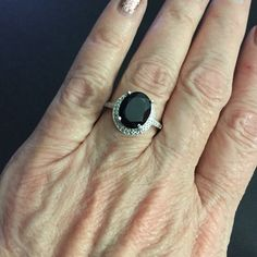 Black Tourmaline Ring sz 8 Stunning 3.25 black tourmaline oval set in Sterling silver with platinum overlay. There's also tiny CZs around it at the bottom of the setting. Pretty on any finger, any day, every day. Size 8 Jewelry Rings