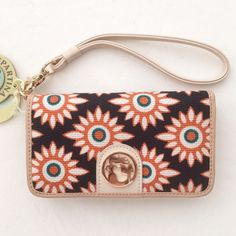 Spartina 449 Tyree Folio phone wristlet I'll be honest; this is priced a little high because I really want to keep it. It is SO cute. Made on Daufuskie Island, NC, in a pattern inspired by local history. Cream, orange, and purple linen with leather.  Perfectly sized for a smartphone (my iPhone 6s fits just right), and other necessities. Various compartments and pockets. NWT; never used. Spartina 449 Bags Clutches & Wristlets