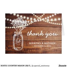 RUSTIC COUNTRY MASON JAR THANK YOU CARD RUSTIC COUNTRY MASON JAR WEDDING THANK YOU CARD | Wooden background with string of lights, mason jar containing baby's breath flowers and your custom wording.