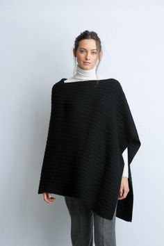 Cable knitted poncho in black
