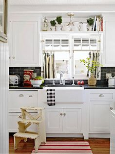 The apron front sink and white custom cabinetry give this kitchen a vintage vibe.
