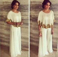 Hit: Bipasha Basu looked quite the diva in a Mayyur Girotra white cape top and palazzo pants. We lov... - Provided by Indian Express Slideshows
