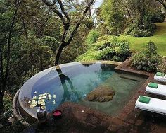 Live on a mountian, or hill in Indiana, try this landscaping with a pool over the edge. Woodsie Beautifulness! woodsie = my new word!
