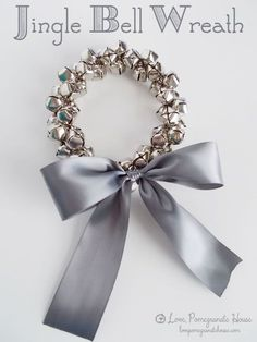 DIY Jingle Bell Wreath. Use on doorknob or as an ornament on tree. Nice neighbor gift idea also. Easy Christmas craft.
