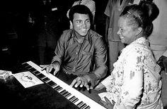 Muhammad Ali chats with Etta James in Kinshasa, Zaire, September 1974.