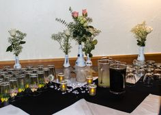 I collected various sized bottles for this Shabby Chic party at a brewery. I painted clean bottles with chalk paint, then sanded them to create the distressed look. I liked how the different colors of glass showed through. A strip of burlap and some Tulle ribbon, completed the look.