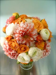 fall wedding flowers orange and white ranunculus: love the color combo