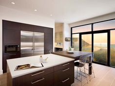 OOOOH LA LA--These look like my cabinets, and the white countertops I want to do. The only difference (besides the view??) is my floors are dark bamboo. Oh, and the kitchen pictured is WAYYYY bigger.