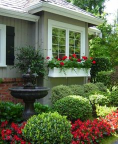 classy what to plant in front of house. Window Box  Curb Appeal WIndow boxes are always a great addition on ANY house Nice flower bed with red accents birdbath and window 13 Tips For Landscaping On A Budget Yards Budgeting