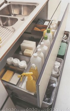 Organize cleaning supplies under the kitchen sink with built in drawer organizers.  Can also use same idea with beauty supplies in the bathroom.  #organization  #storage  #kitchen  #bathroom