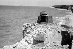 A knocked out German ft 17 turret defensive position at Point Du Hoc Normandy June 1944