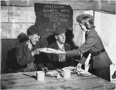 Mrs Cripps, daughter-in-law of Mr Leonard Cripps, serves American baked ham to feed dockyard workers in a marquee being used as an emergency feeding centre on the outskirts of Liverpool. Steak And Seafood, Grilled Seafood, Liverpool Docks, Custom Sheds, The Blitz, Baked Ham, Bad Feeling, Catching Fire, British History