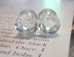 Stunning Solid cubic zirconia double flare saddle plugs.    00, 0, 2, 4, 6 Gauge.    Please indicate size at checkout Please.