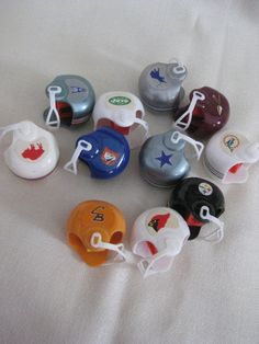 Choose your team!  This listing is for one NFL helmet pencil sharpener. The beauty of these is that the majority feature old logos no longer used, even ones that represent an old team name (like the Houston Oilers to Tennessee Titans!)  Each plastic helmet measures approx. 1 3/8 inches. All have two decals with the exception of one sharpener.  Choose your sharpener choice from the drop-down list.  Included are:  Pittsburg Steelers (one decal) Buffalo Bills Denver Broncos Cleveland Browns…
