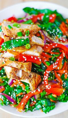 Asian chicken spinach salad with ginger sesame dressing. Healthy, lean, and easy: it takes only 30 minutes to prepare.