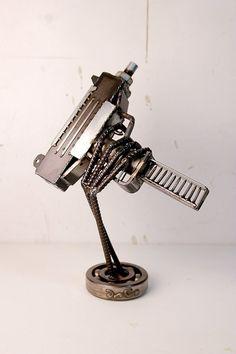 scrap metal UZI by devincahow on Etsy