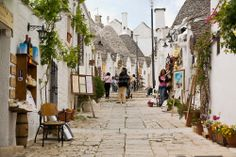 Tourists shopping and sightseeing in Alberobello, Apulia, Italy