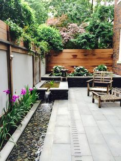 Youd be surprised how well a small patio can take on water features. This urban garden in Washington D. has a wonderfully scaled stepped-down narrow trough fountain that hugs the perimeter of the patio and helps to mitigate the city noise.