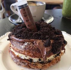 A chocolate syringe-filled cronut from The Grumpy Barista, Petersham. | 19 Of The Most Insane Desserts You Need To Try In Sydney