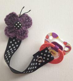 Crochet Purple Polka Dot Butterfly Pacifier Holder. $5.95, via Etsy.