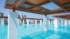 Amirandes, Grecotel - Pool wooden shades