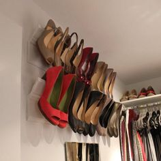 Crown Molding as a wall mounted shoe rack for heels. Why didn't I think of that?! So easy and effective.