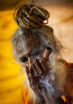 ig_mood,passionpassport-A Naga Sadhu Smoking Pot, Maha Kumbh Mela, Allahabad, India If you wish to get a signed print of one of my pics please send We Are The World, People Of The World, Sadhus India, Shiva Wallpaper, Wine Wallpaper, Kumbh Mela, Lord Shiva Painting, Shiva Shakti, Shiva Art