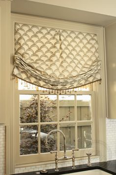 Relaxed roman shade with bead fringe. Love the print!