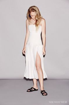 Maika Monroe wears a strapless pleated chiffon dress with black sandals