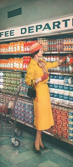 Ha. I always [never] look like this when I'm grocery shopping. hehe. A stylishly attired woman shops for coffee at a Kroger supermarket, 1957.