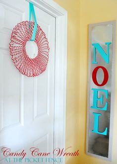 Two in one picture. Love the wreath made out of Dollar Tree Candy Canes. Love the idea of framed metal by the door with magnets that can be changed out seasonally.