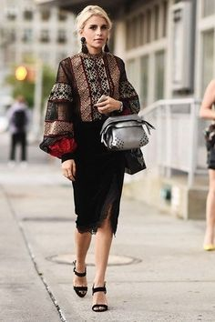 Caroline Daur wears oversized earrings and a midi-skirt with a bohemian top with exaggerated sleeves. We love her look!