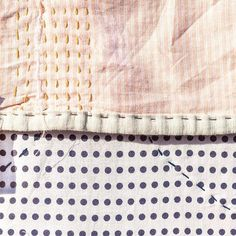 """Simple patterns and pastel colours. Keeping it simple is the hardest. You always tend to add some details in order to hide the imperfections.  Here I decided to show it: uneven cut of the striped fabric, """"drunk"""" running stitch between polka dots and many other things. Let's hug the imperfections in our lives, they make us better. ⠀ . . . .  #polkadot #thread #handstitching #slowstitching #dustypink #indigo #indigodye #aizome #藍染 #embroidery #embroiderylove #embroiderydesign #modernembroidery…"""