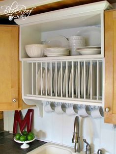 Update builder grade kitchen cabinets with a plate rack cabinet. | Remodelaholic