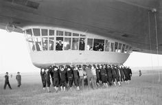 Ground crew swings into action to help land the Hindenburg dirigible May 9, 1936, a year before a disaster.