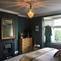 A Modern Victorian Home Tour - Estelle Derouet | Painted in Farrow and Balls Inchyra Blue, the master bedroom is Estelle's sanctuary and you can see why. Lots of natural light floods in through large Victorian windows. #homedecor #modernvictorian #farrowandball #bedroominspo #victoriandecor #interiors #interiorinspo #interiordesign #interiorstyle #victorianbedroomdecor #bedroomdecor #decor #homestyle