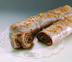 Makowiec zwijany Zwijane delikatne ciasto drożdżowe z makiem i dużą ilością bakalii. Obsypany skórką pomarańczową. Makowiec zwijany jest to produkt sezonowy, sprzedawany w okresie Bożonarodzeniowym.