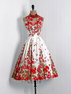 A bright, summery floral print on the 1950s dress.