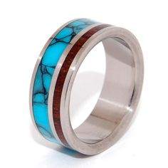Essential elements. Titanium, Natural, black-webbed Turquoise and Koa wood naturally compliment each other in this stunning asymmetrical titanium band. Native Hawaiian Koa wood is a perfect pick for i
