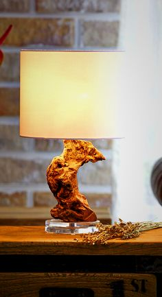 Teak Root Table Lamp. This Unique Design Accent Light is made from Dead Teak Trees' Roots, a type of driftwood, treated and assembled on Acrylic. With a natural look , this Masterpiece looks gorgeous and creates ambiance environment, brighten your days with interesting lights. It's great when placing on sofa sides your living room or bed sides bedroom. It could perfectly fit with industrial, loft or country home styles. Find more Creative Ideas from O'THENTIQUE's Designer on our site!